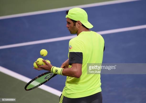 Malek Jaziri of Tunisia chooses the balls during his quarter final match against Stefanos Tsitsipas of Greece on day four of the ATP Dubai Duty Free...