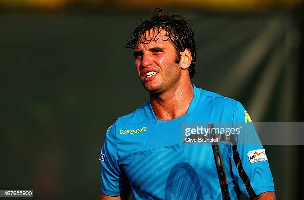 Malek Jaziri of Tunisia during the change over against Steve Darcis of Belgium in their first round match during the Miami Open at Crandon Park...