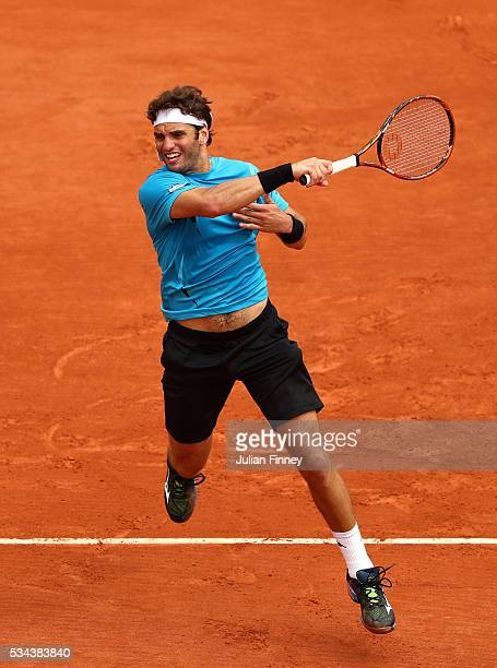 Malek Jaziri of Tunisia hits a forehand during the Men's Singles second round match against Tomas Berdych of Czech Republic on day five of the 2016...