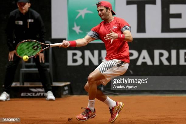 Malek Jaziri of Tunisia in action against Laslo Djere of Serbia during TEB BNP Paribas Istanbul Open men's singles tennis match at the Garanti Koza...