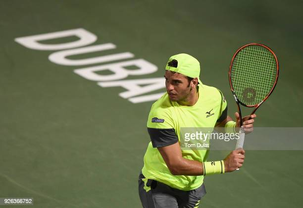 Malek Jaziri of Tunisia in action during his semi final match against Roberto Bautista Agut of Spain on day five of the ATP Dubai Duty Free Tennis...