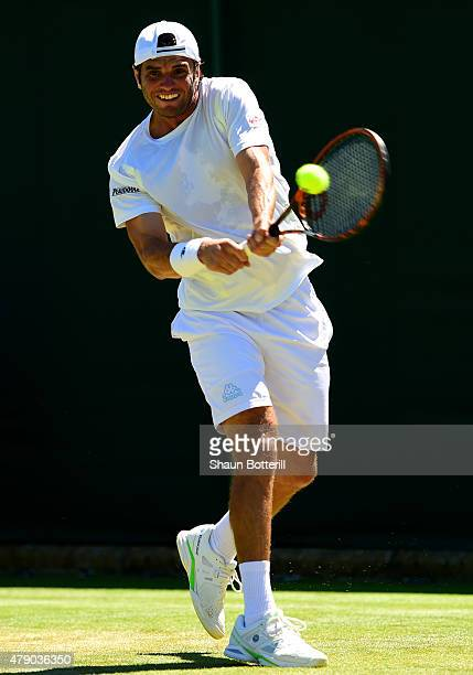 Malek Jaziri of Tunisia in action in his Gentlemen's Singles first round match against James Duckworth of Australia during day two of the Wimbledon...