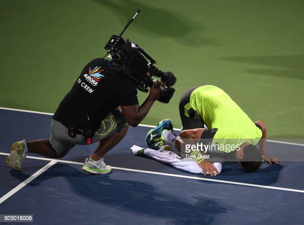 Malek Jaziri of Tunisia kisses the court after his win against Grigor Dimitrov of Bulgaria on day two of the ATP Dubai Duty Free Tennis Championships...