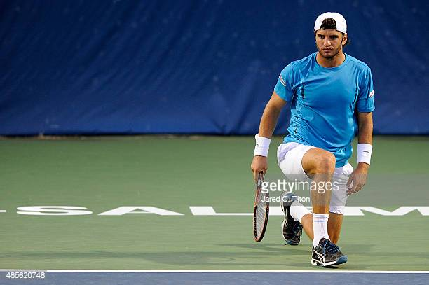 Malek Jaziri of Tunisia looks on during his match against Kevin Anderson of South Africa during the fifth day of the WinstonSalem Open at Wake Forest...