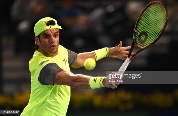 Malek Jaziri of Tunisia plays a backhand against Grigor Dimitrov of Bulgaria on day two of the ATP Dubai Duty Free Tennis Championships at the Dubai...