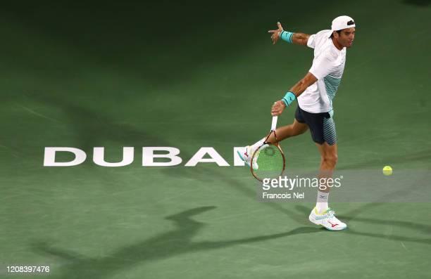 Malek Jaziri of Tunisia plays a backhand against Novak Djokovic of Serbia during his men's singles match on Day Eight of the Dubai Duty Free Tennis...