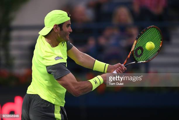 Malek Jaziri of Tunisia plays a backhand during his quarter final match against Stefanos Tsitsipas of Greece on day four of the ATP Dubai Duty Free...