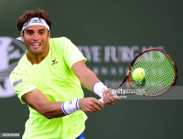 Malek Jaziri of Tunisia plays a backhand losing to Jack Sock during the BNP Paribas at Indian Wells Tennis Garden on March 15 2017 in Indian Wells...