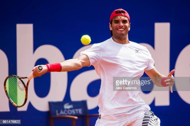 Malek Jaziri of Tunisia plays a forehand against Grigor Dimitrov of Bulgaria in their match during day four of the Barcelona Open Banc Sabadell on...