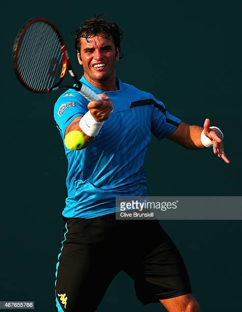 Malek Jaziri of Tunisia plays a forehand against Steve Darcis of Belgium in their first round match during the Miami Open at Crandon Park Tennis...
