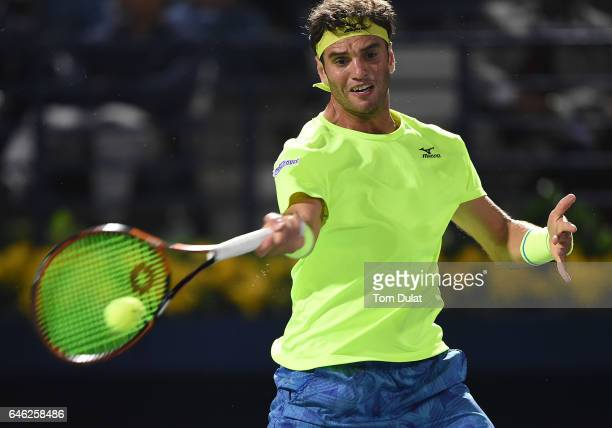 Malek Jaziri of Tunisia plays a forehand during his match against Andy Murray of Great Britain on day three of the ATP Dubai Duty Free Tennis...