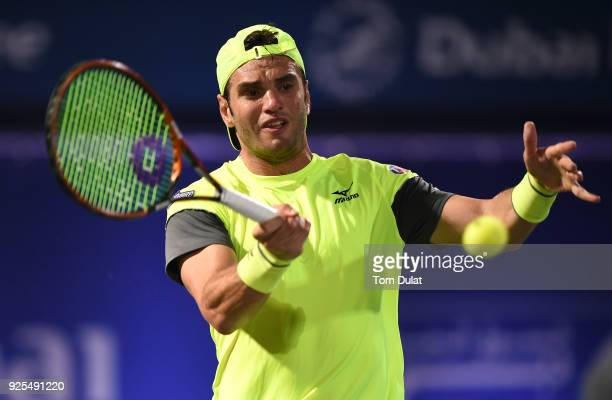 Malek Jaziri of Tunisia plays a forehand during his match against Robin Haase of Netherlands on day three of the ATP Dubai Duty Free Tennis...