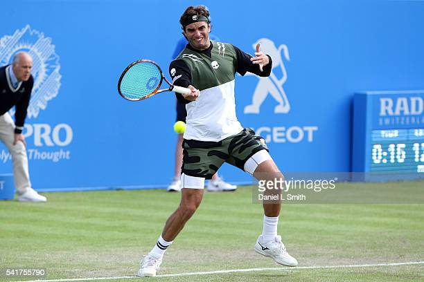 Malek Jaziri of Tunisia plays a forehand during his men's singles match against James Ward of Great Britain during day one of the ATP Aegon Open...