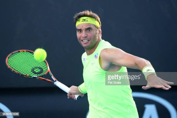 Malek Jaziri of Tunisia plays a forehand in his first round match against Salvatore Caruso of Italy on day one of the 2018 Australian Open at...