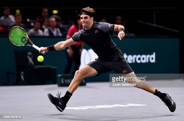 Malek Jaziri of Tunisia plays a forehand in his second round match against Fernando Verdasco of Spain during Day 3 of the Rolex Paris Masters on...