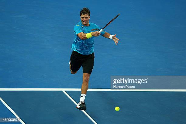 Malek Jaziri of Tunisia plays a forehand in his third round match against Nick Kyrgios of Australia during day five of the 2015 Australian Open at...