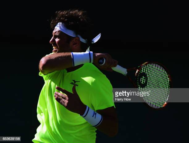 Malek Jaziri of Tunisia plays a forehand losing to Jack Sock during the BNP Paribas at Indian Wells Tennis Garden on March 15 2017 in Indian Wells...