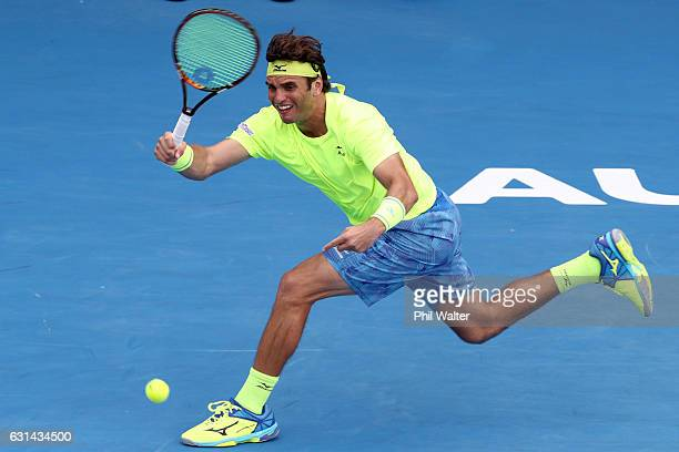 Malek Jaziri of Tunisia plays a return during the mens singles match between John Isner of the USA and Malek Jaziri of Tunisia on day 10 of the ASB...