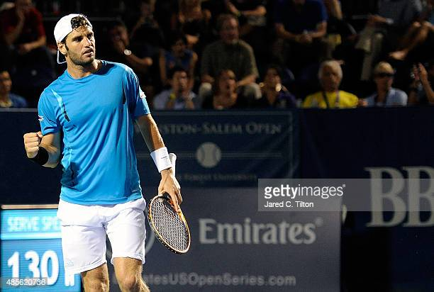 Malek Jaziri of Tunisia reacts after a point during his match against Kevin Anderson of South Africa during the fifth day of the WinstonSalem Open at...