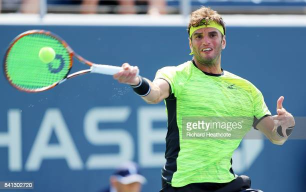 Malek Jaziri of Tunisia returns a shot against John Millman of Australia during their second round Men's Singles match on Day Four of the 2017 US...