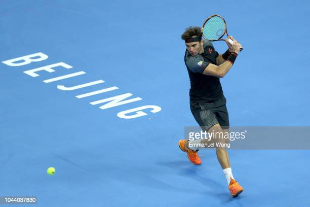 Malek Jaziri of Tunisia returns a shot against Wu yibing of China during the Men's singles first round match on day three of 2018 China Open at the...