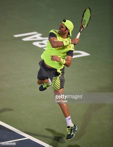 Malek Jaziri of Tunisia returns a shot during his quarter final match against Stefanos Tsitsipas of Greece on day four of the ATP Dubai Duty Free...