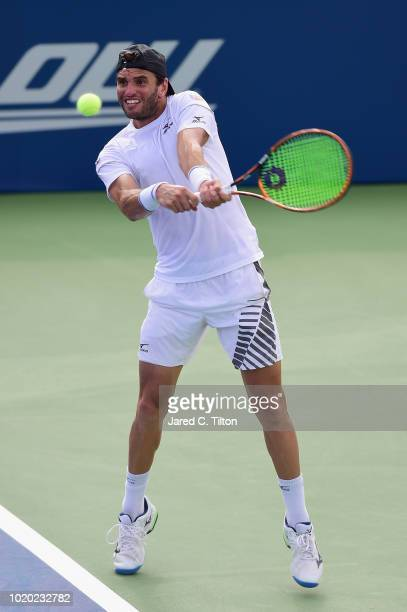 Malek Jaziri of Tunisia returns a shot from Taylor Fritz during the first day of the WinstonSalem Open at Wake Forest University on August 20 2018 in...