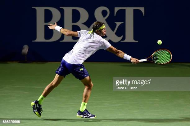 Malek Jaziri of Tunisia returns a shot from Taylor Fritz during the third day of the Winston-Salem Open at Wake Forest University on August 21, 2017...