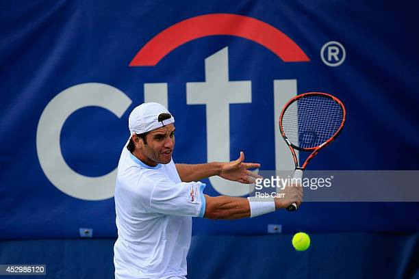Malek Jaziri of Tunisia returns a shot to Kevin Anderson of South Africa during the Citi Open at the William HG FitzGerald Tennis Center on July 31...
