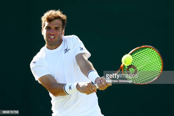 Malek Jaziri of Tunisia returns against Jared Donaldson of the United States on day one of the Wimbledon Lawn Tennis Championships at All England...