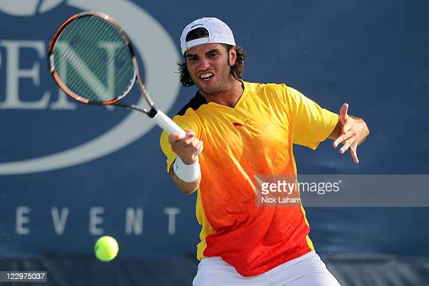 Malek Jaziri of Tunisia returns the ball against Thiemo de Bakker of Netherlands during Day One of the 2011 US Open at the USTA Billie Jean King...