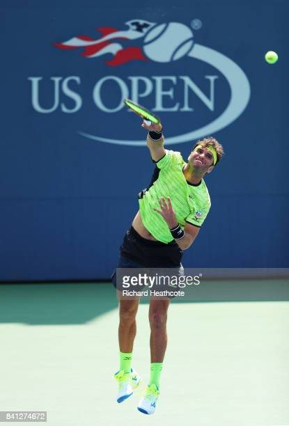 Malek Jaziri of Tunisia serves against John Millman of Australia during their second round Men's Singles match on Day Four of the 2017 US Open at the...