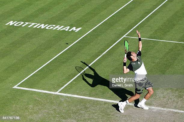 Malek Jaziri of Tunisia serves during his men's singles match against James Ward of Great Britain during day one of the ATP Aegon Open Nottingham at...