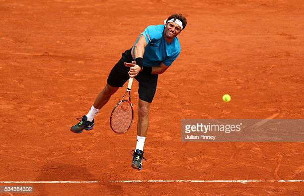 Malek Jaziri of Tunisia serves during the Men's Singles second round match against Tomas Berdych of Czech Republic on day five of the 2016 French...