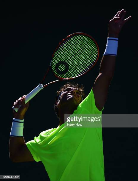 Malek Jaziri of Tunisia serves in his losing match to Jack Sock during the BNP Paribas at Indian Wells Tennis Garden on March 15 2017 in Indian Wells...