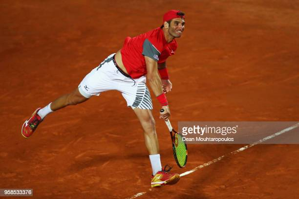 Malek Jaziri of Tunisia serves in his match against Kyle Edmund of Great Britain during day two of the Internazionali BNL d'Italia 2018 tennis at...