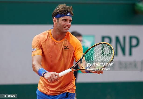 Malek Jaziri of Tunisia serves in his mens singles first round match against Oscar Otte of Germany during Day one of the 2019 French Open at Roland...