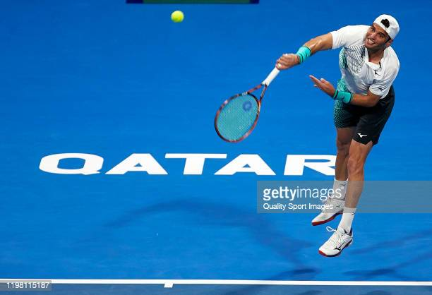 Malek Jaziri of Tunisia serves in his mens singles second round match against Mikhail Kukushkin of Kazakhstan during day two of the ATP Qatar...