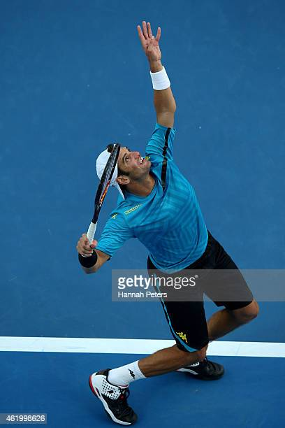 Malek Jaziri of Tunisia serves in his third round match against Nick Kyrgios of Australia during day five of the 2015 Australian Open at Melbourne...