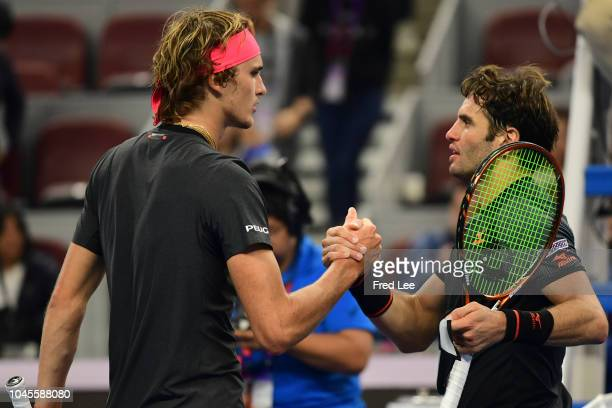 Malek Jaziri of Tunisia shakes hands with Alexander Zverev of Germany during their Men's Singles 2nd Round match of the 2018 China Open at the China...