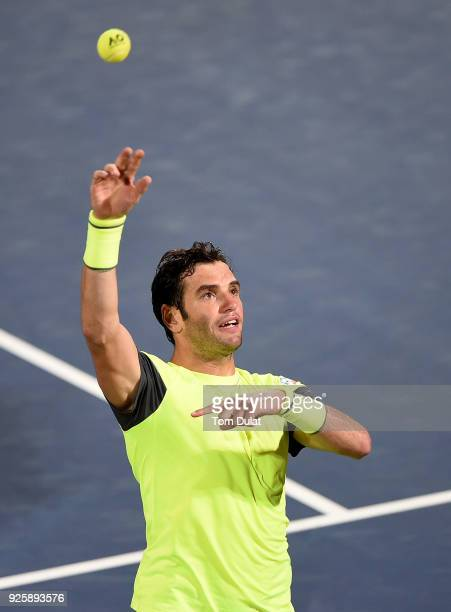 Malek Jaziri of Tunisia throws his ball into the crowd after winning his quarter final match against Stefanos Tsitsipas of Greece on day four of the...