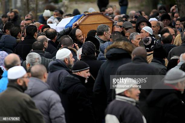 Malek Merabet carries the coffin of his murdered brother police officer Ahmed Merabet during his funeral at Bobigny Muslim cemetery on January 13...