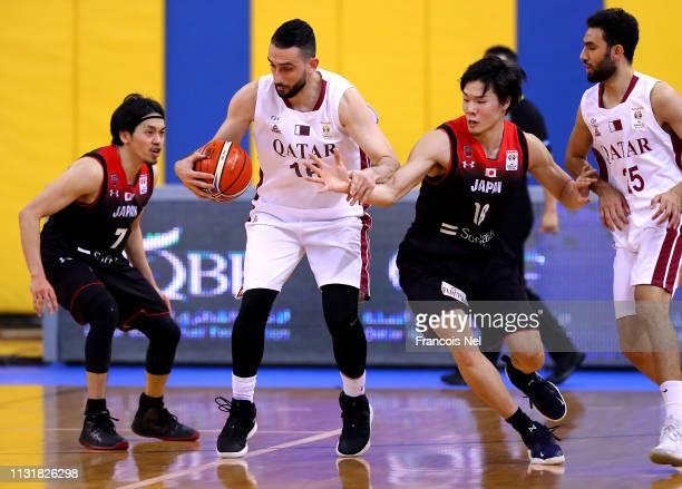 Malek Salem Abdulla of Qatar controls the ball during the FIBA Basketball World Cup 2019 Asian Qualifier between Qatar and Japan at Al Gharrafa Sport...
