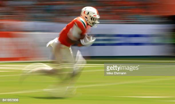 Malek Young of the Miami Hurricanes returns a kick during a game against the Bethune Cookman Wildcats at Hard Rock Stadium on September 2 2017 in...