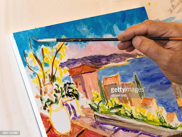 Malen mit Wasserfarben Maler malt ein Landschaftsbild