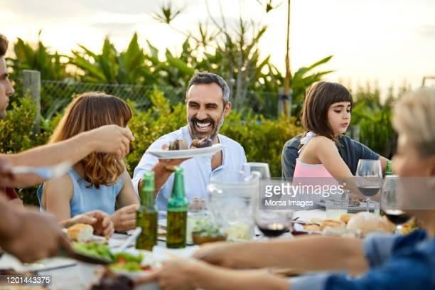 males and females celebrating asado in backyard - cultura argentina imagens e fotografias de stock