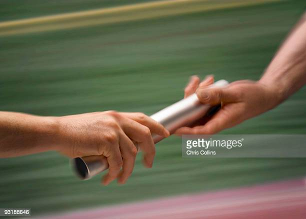males passing baton - stab stock-fotos und bilder