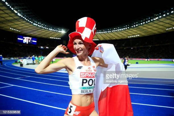 Malgorzata Holub Kowalik of Poland celebrates after winning the gold medal in the Women's 4x400m relay final during the 2018 European Athletics...