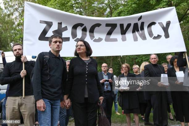 Malgorzata Rybicka Aram wife and his son under the quotVillainsquot banner are seen in Gdansk Poland at the Srebrzysko cemetery on 14 May 2018 The...