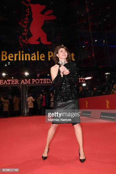 Malgorzata Szumowska winner of the Silver Bear Grand Jury Prize for 'Mug' poses on the red carpet after the closing ceremony during the 68th...